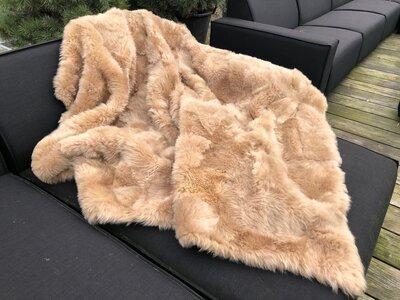 Schapenvacht kleed in warme tinten beige/cognac